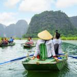 NINH BINH PROVINCE, VIETNAM – OCTOBER 14, 2015: Tourists traveli
